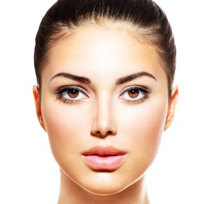 Beautiful facial skin women using skin care products